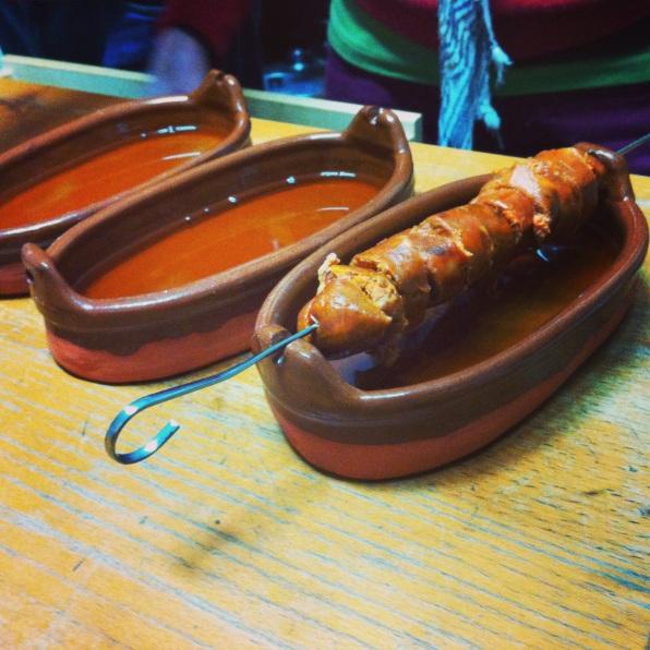 preparing chorizo al infierno- Cartajima, Spain.