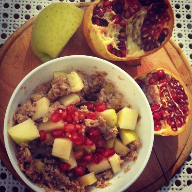 Morning porridge with apples and pomegranate- Spain.