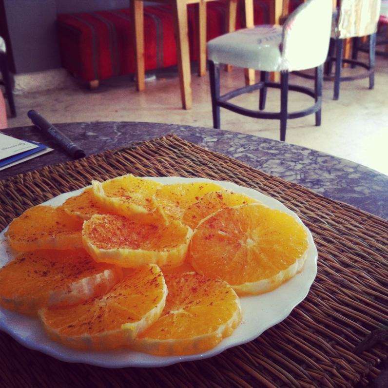 A citrusy dessert, cinnamon-sprinkled oragnes. Marrakech,
