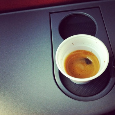 Coffee time on board a bus, heading toward Rome. Espresso in a plastic cup.