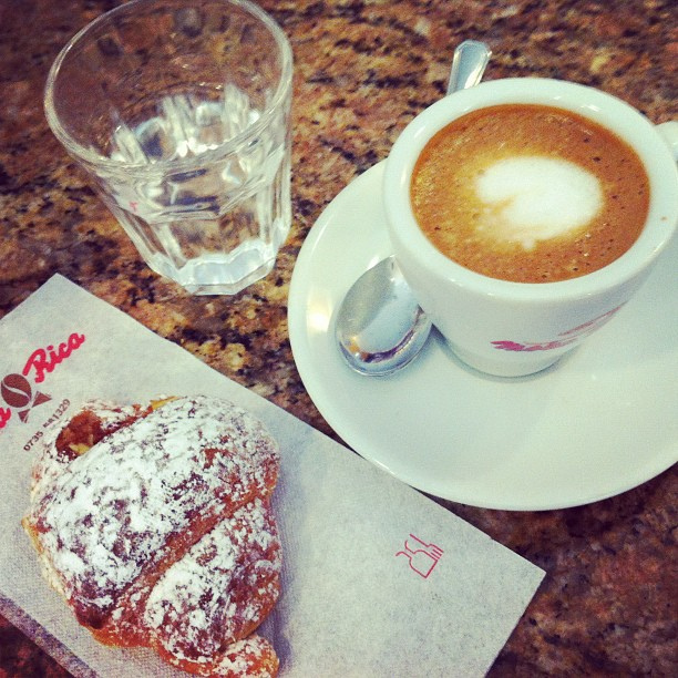 Macchiatto and a croissant in Italy.