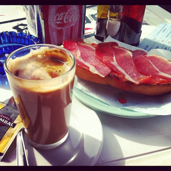 Cafe con leche and a jamon tostada for breakfast in Granada, Spain.